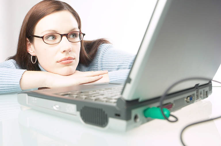 Woman using watching laptop computer screen