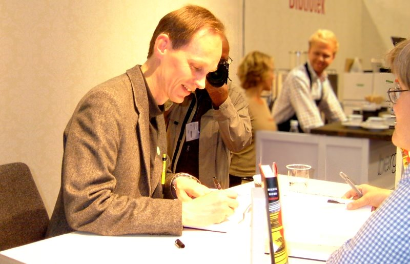 mikael niemi, author, book signing at a book show
