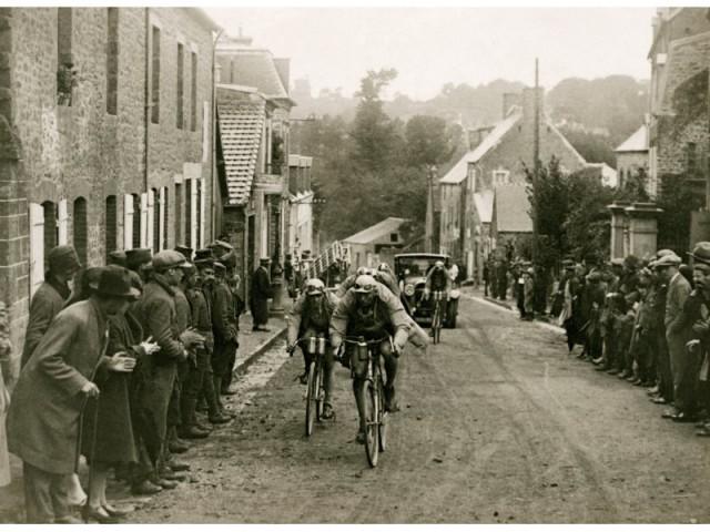 tour de france racing through a village
