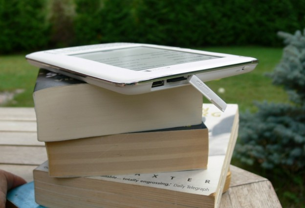 elonex ereader, stack of books