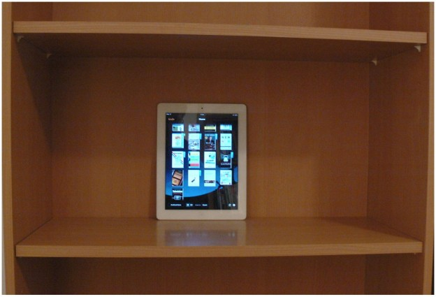 ipad tablet in a bookshelf