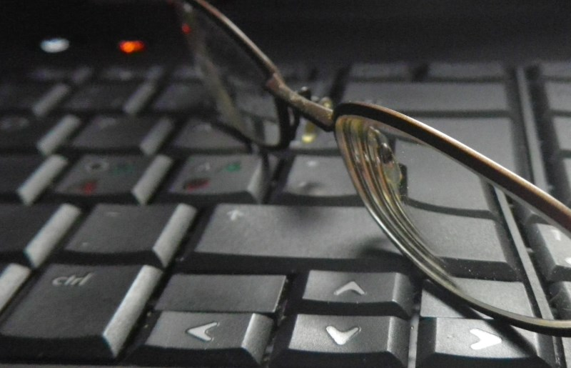 eyeglasses on computer keyboard