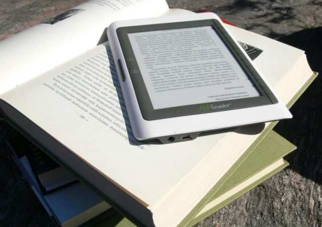 ereader on top of stack of books