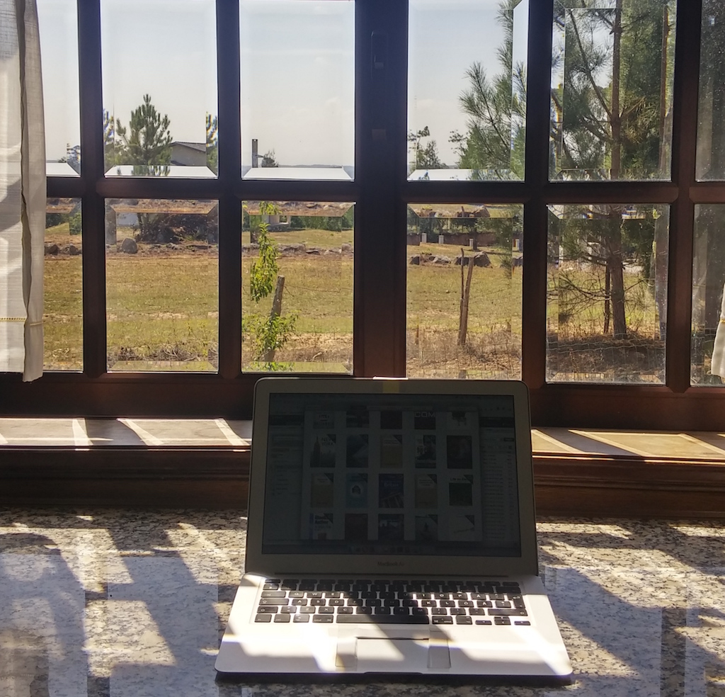 North Portugal, office of a digital nomad on kitchen table