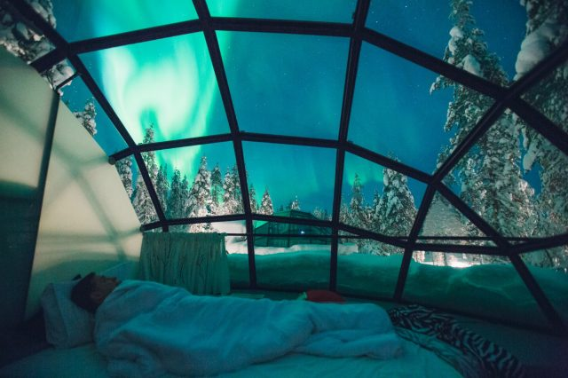 NorthernLights, through a glass ceiling. Photo: Kakslauttanen Arctic Resort