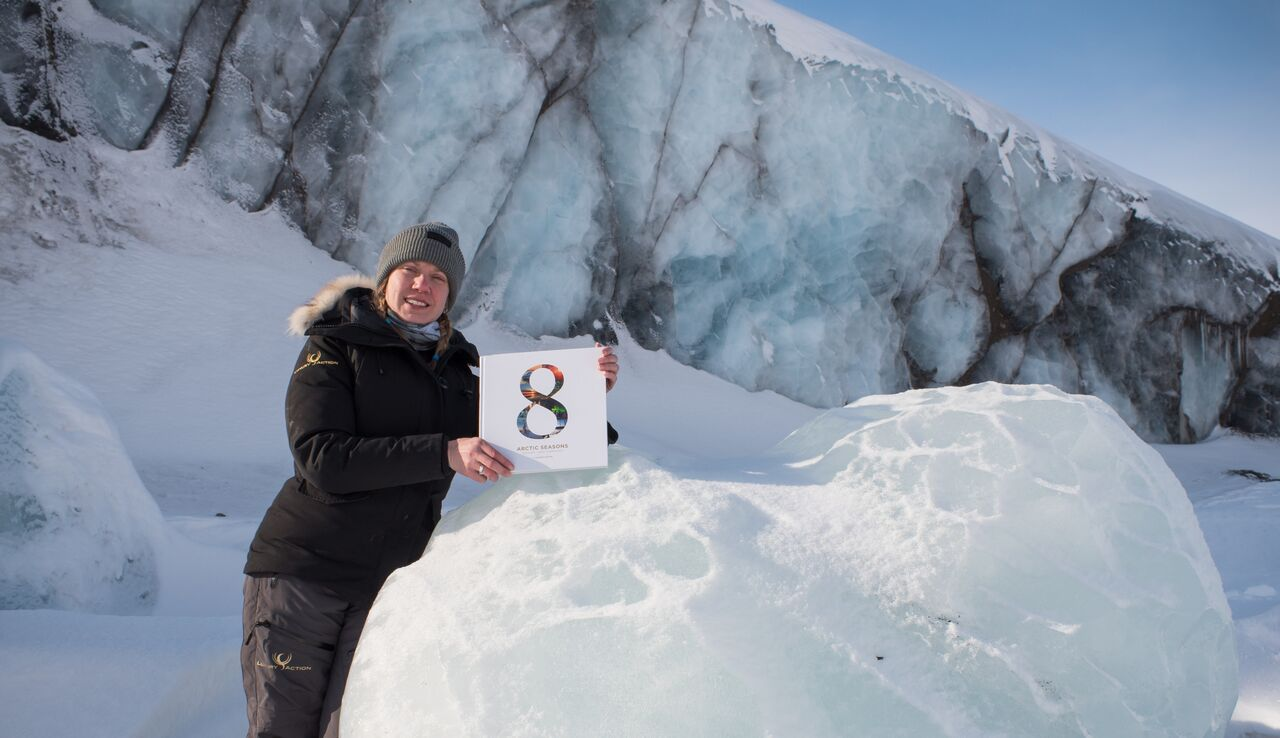 8 Arctic Seasons book in the snow with Liisa Kokkarinen