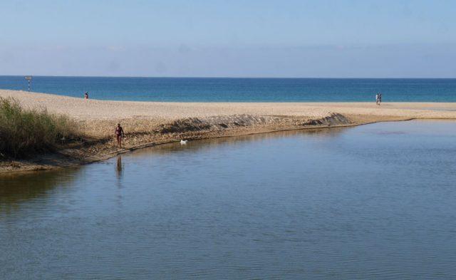 Salgados, Armacao de Pera, Algarve, Portugal. River meets the sea