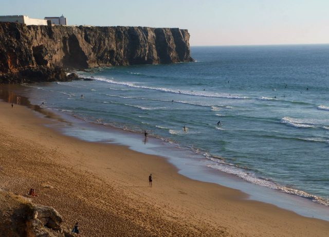 Surfers in Sagres, Algarve, Portugal.