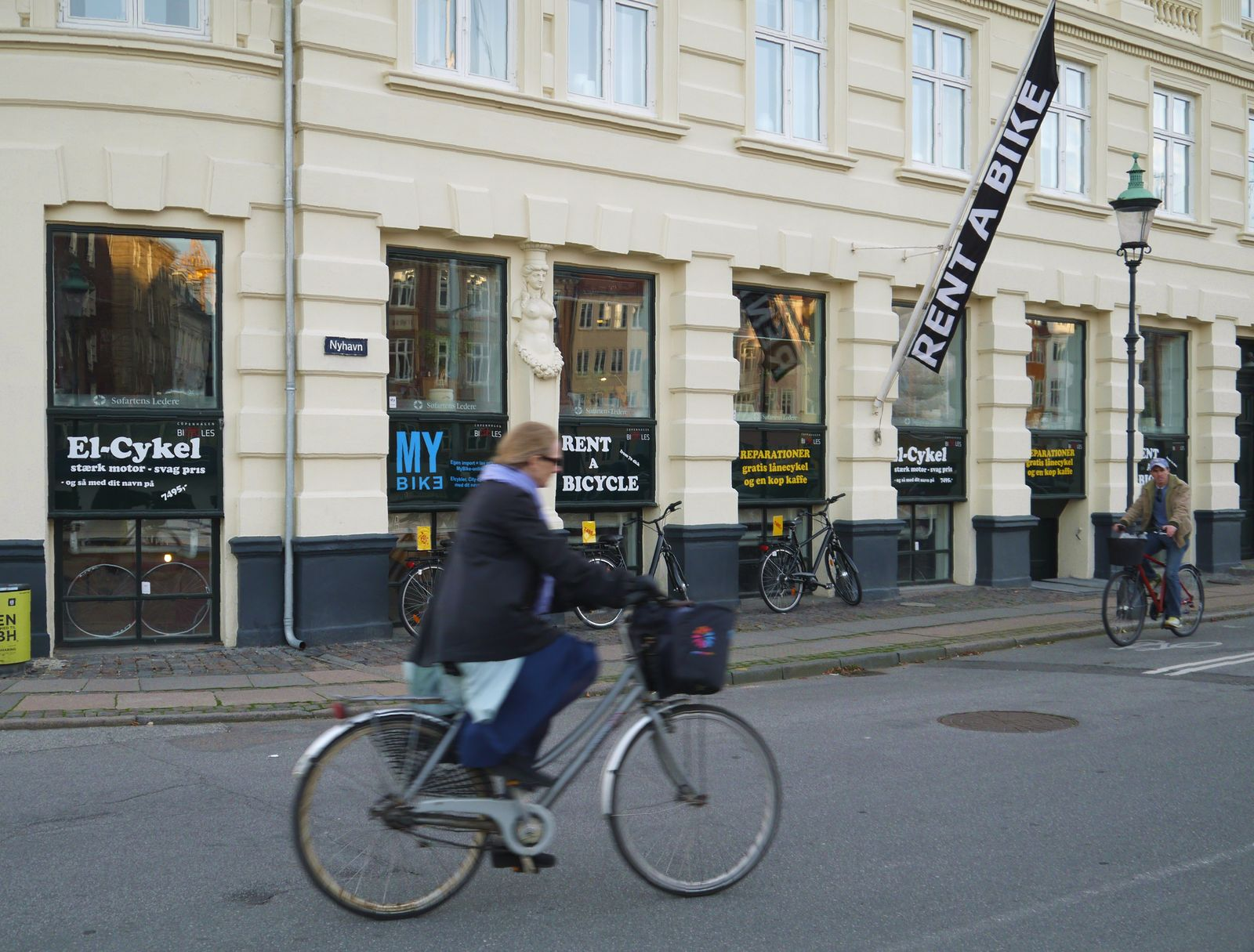 Copenhagen, Denmark: cyclists in front of bicycle rental shop in the city center