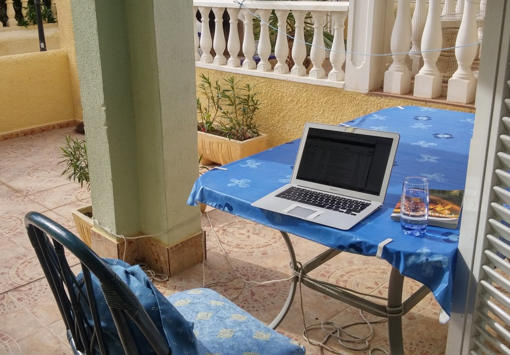 digital nomad's office on an outdoor terrace in Italy