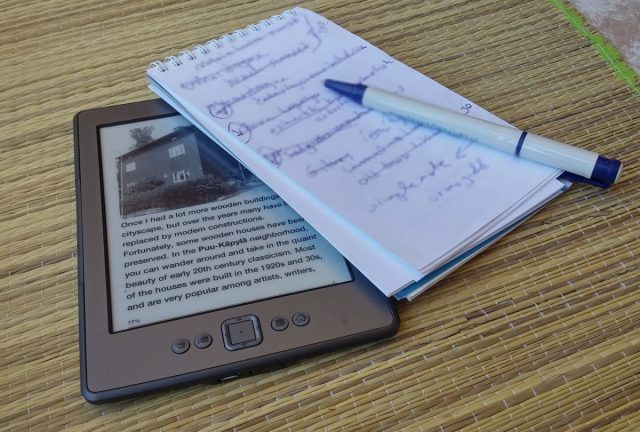 Kindle ereader, notepad, pen