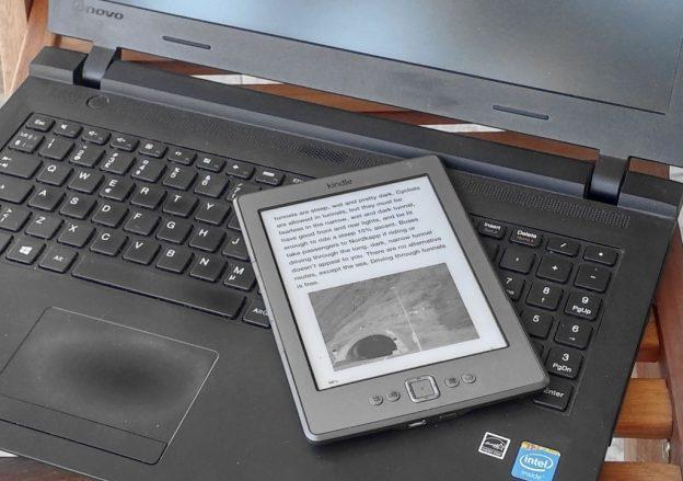 Amazon Kindle ereader on laptop keyboard