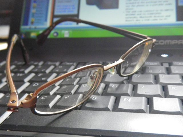 writer's eyeglasses on computer keyboard