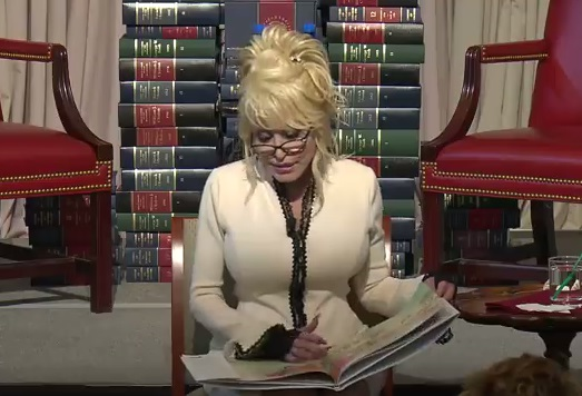 Dolly Parton reading a book at the Library of Congress, Washington