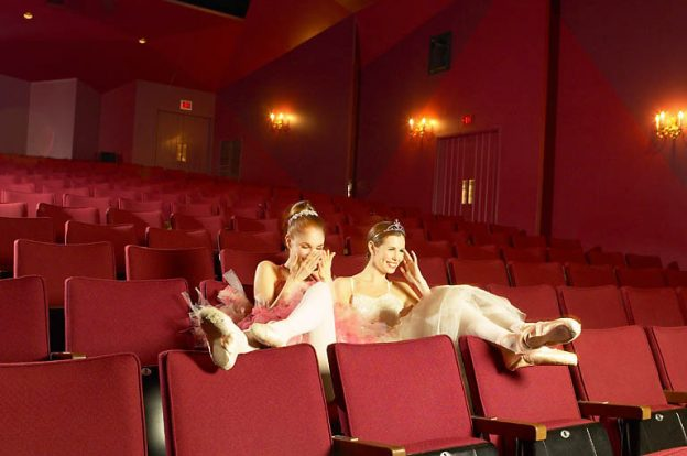 ballerinas watching at stage in a theater
