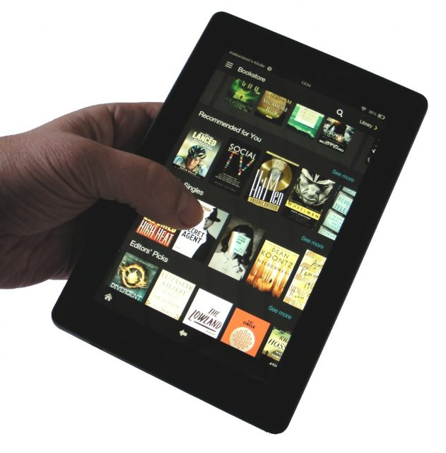 Amazon Fire tablet in hand