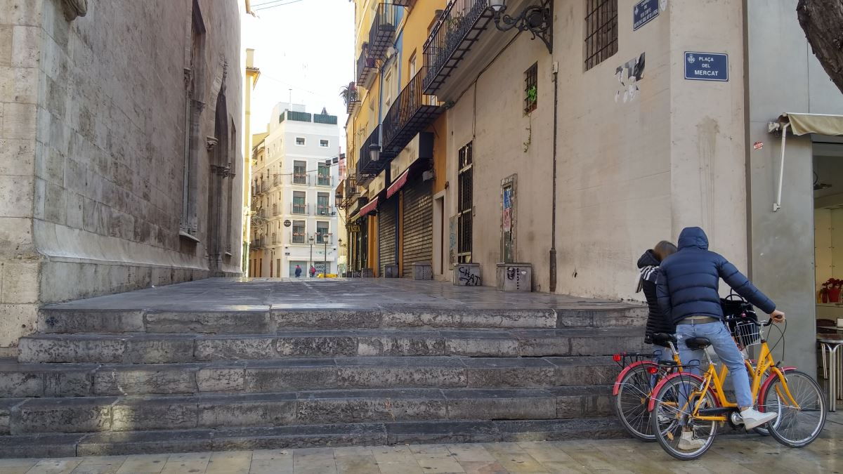 Valencia, Spain. cyclists studying a map in the old town.