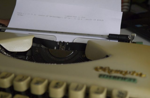 text on paper type on an old typewriter