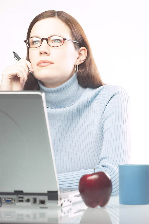woman thinking what to write, laptop, pen, apple on desk