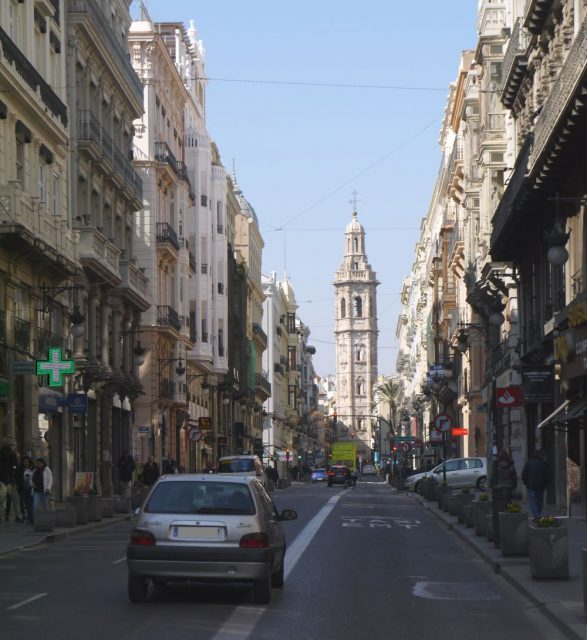 a main street in the city street leads to Plaza de la Reina in Valencia, Espana