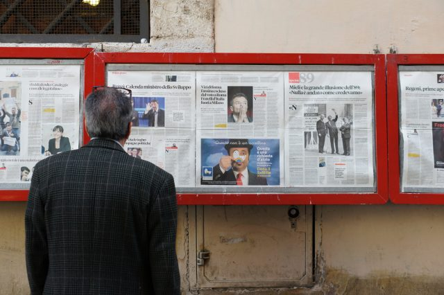 man reading old bulletin board news. Photo by Filip Mishevski.