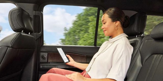 kobo libra h2o e-reader, woman reading in car