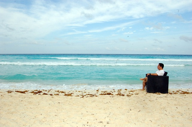 man sitting in chair at a beach. photo vic padilla.