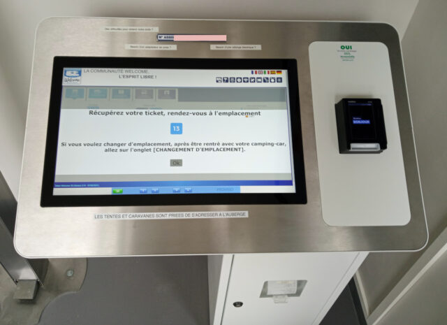 check in computer at campervan site in france